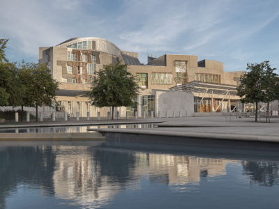 Frontage of the Scottish Parliament Building and adjacent pool in Edinburgh, Scotland.